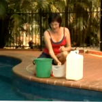 Adding chemicals to pool