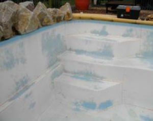 Faded fibreglass pool